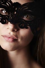 Gorgeous masked young woman, portrait