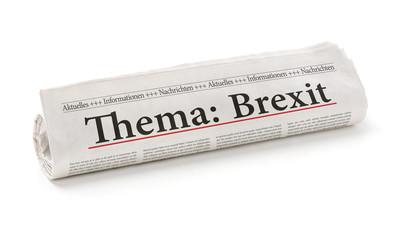 Zeitungsrolle mit der Überschrift Brexit