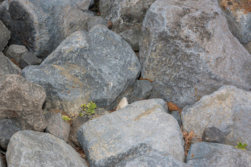 Large mountain stone pile in nature.