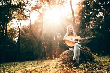 Beautiful hippie playing  guitar