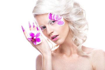 Beautiful girl with art make-up, flowers, curls and long nails. Manicure design. The beauty of the face.