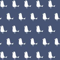 White bird seamless pattern on blue background