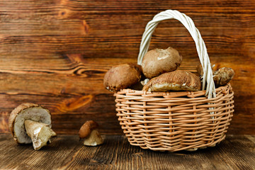 White mushrooms in rustic wicker basket.