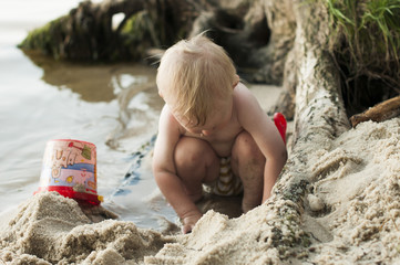 child  bathes in the river