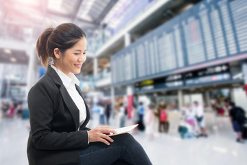business traveler waiting with airport background