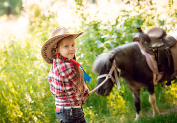Beautiful little girl on a pony.