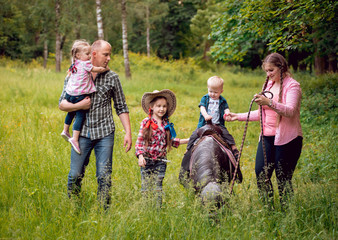 Family walks with ponies.