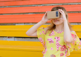 Young woman having fun with virtual reality glasses