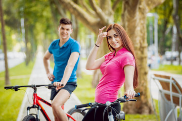 Cycling young couple.