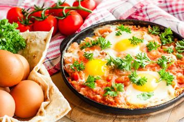 Aluminium Prints Egg fried eggs in tomato sauce, shakshuka