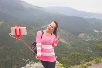 Young traveler taking a selfie picture.