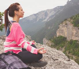 Young traveler girl relaxing in mountais