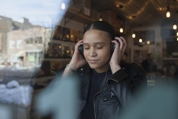 Young woman wearing headphones.