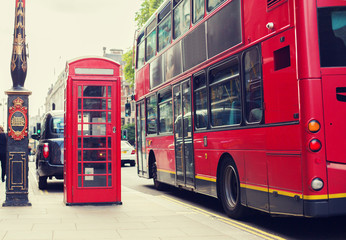 double decker bus and telephone booth in london