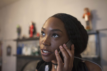Close up of young woman talking on smartphone
