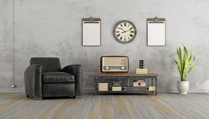 Vintage living room with black armchair and old radio