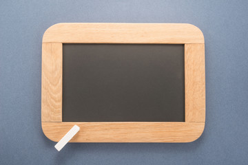 Blackboard with chalk on blue background