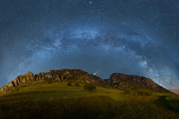 Milky way over Piatra Secuiului in Romania panorama