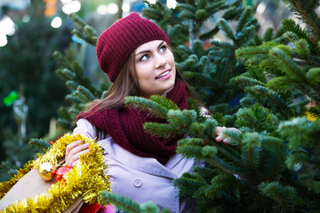 Woman  choosing New Year's tree