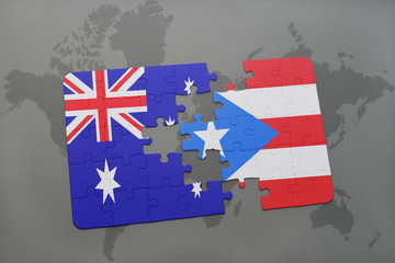 puzzle with the national flag of australia and puerto rico on a world map background.