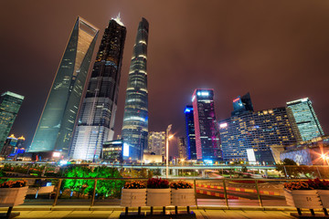 Night view of famous skyscrapers and other modern buildings