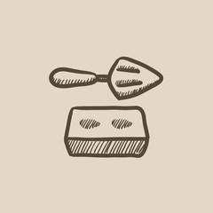 Spatula with brick sketch icon.