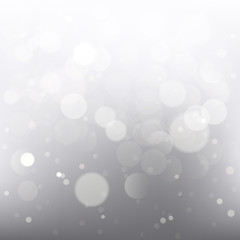 Beautiful celebration background with white and grey color toned blurred lights.