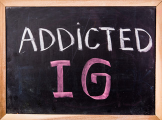 addicted IG  word on blackboard