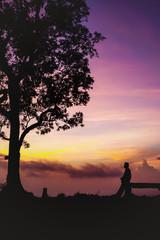Beautiful silhouette tourist having fun at sunset time