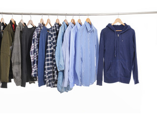 Variety of multicolored casual men's clothes shirts ,jacket on hangers