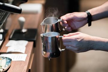 Spoed Foto op Canvas Barista making fresh coffee latte.