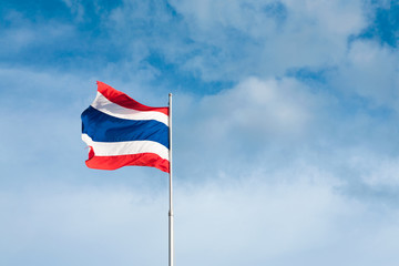 Flag of Thailand with blue sky
