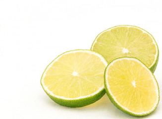 Three slices of lime on white background in bottom right corner