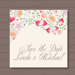 Wedding invitation with hearts and flowers on wooden background