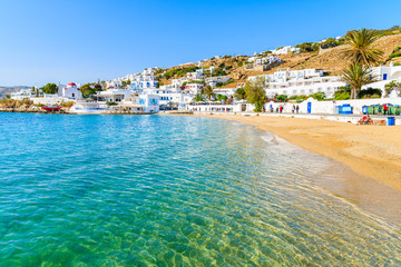 Fototapete - Beautiful beach with crystal clear sea water in Mykonos town, Cyclades, Greece