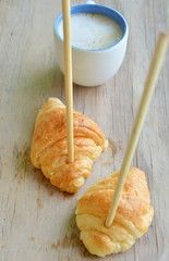 croissant stab chopstick walk to hot latte coffee cup