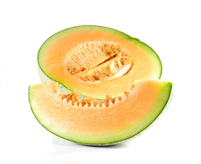 Melon cut pieces on white background.