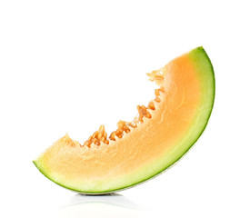 Melon cut pieces on white background.