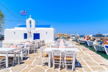 Square with typical white Greek church in Naoussa port, Paros island, Cyclades, Greece
