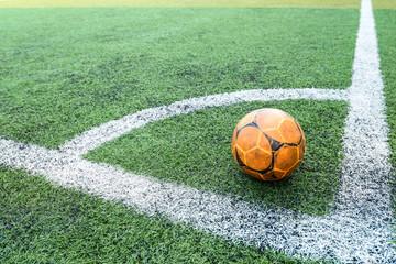 old football ball on coner in  football field