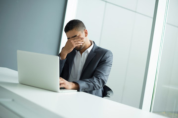 Worried businessman. Feeling exhausted.