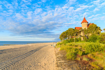 Fototapete - A view of Leba beach and historic hotel building on sand dune, Baltic Sea, Poland