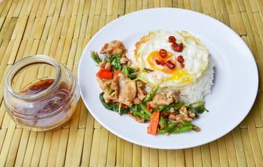 spicy stir fried pork with basil leaf and egg on rice