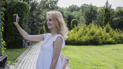 The smartphone in the hands of a young woman