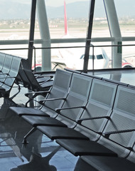 Airport lounge or waiting area with empty seat.
