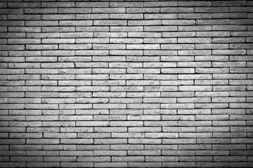 Black and white brick wall texture. Brick wall background for design. Closeup brick texture. Grunge retro vintage of brick wall. Part of brick wall with copy space for text or image. Dark edged.