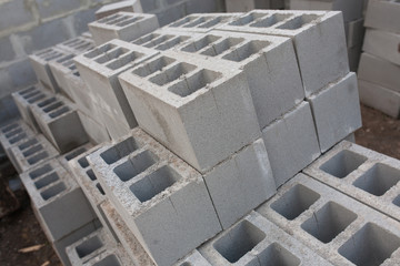 Stack of cement blocks at the construction site. cinder blocks background.