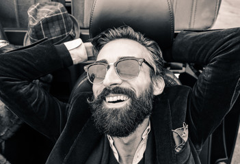 Fashion portrait of young bearded hipster man