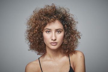Portrait of redheaded woman with curly hair