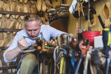 Cobbler making shoes in his workshop
